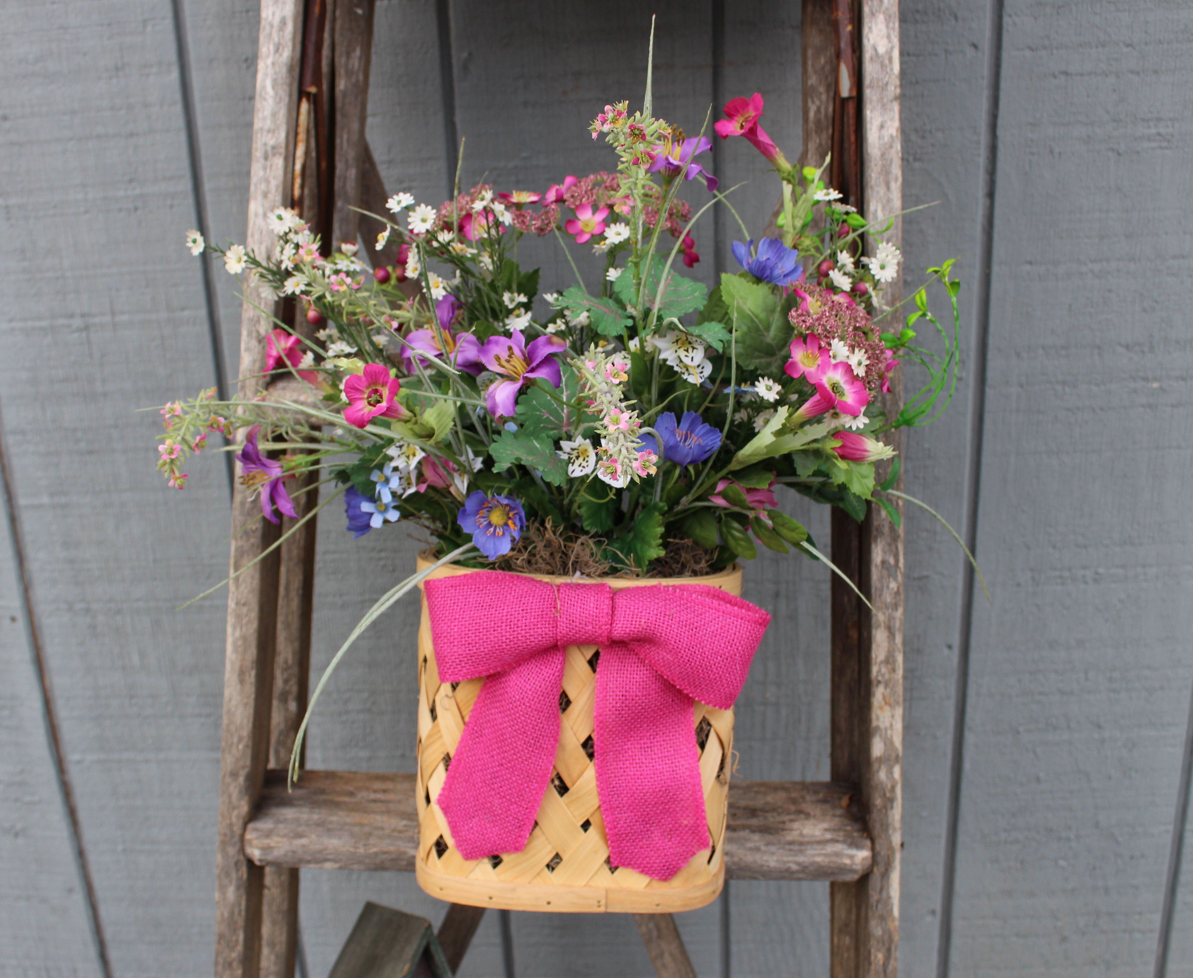 Spring flower basket with pink bow