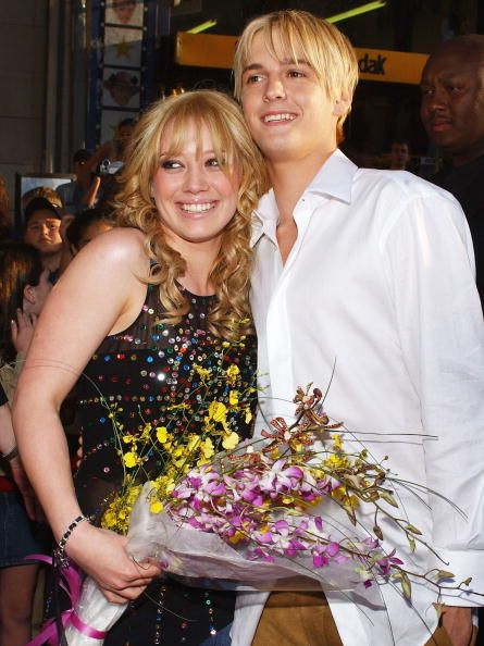 Actress Hilary Duff hugs singer Aaron Carter as they attend the premiere of The Lizzie McGuire Movie on April 26 2003 in Hollywood California