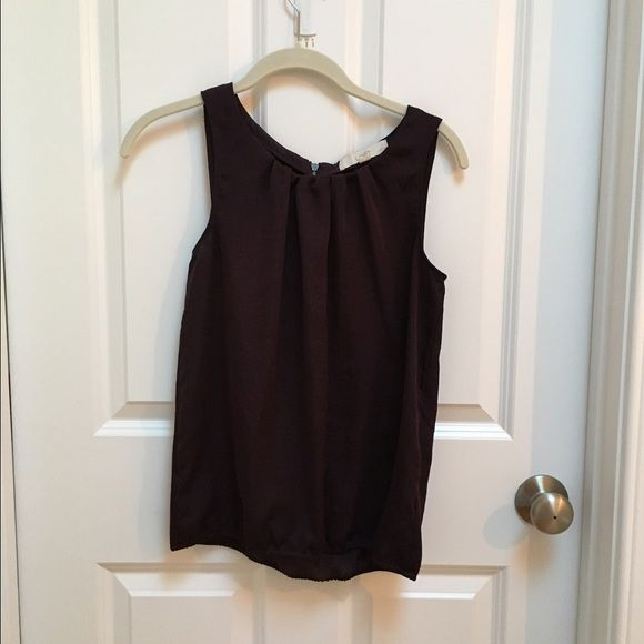 LOFT sleeveless blouse Deep plum color, loose fitting tank, slightly fitted at bottom, zipper in back. Worn once.  100% polyester. Machine wash. New condition. LOFT Tops Blouses