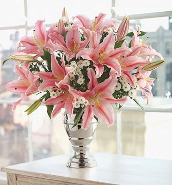 Oriental Pink Lily With Small White Flowers Arrangement Elegant Silver Vase