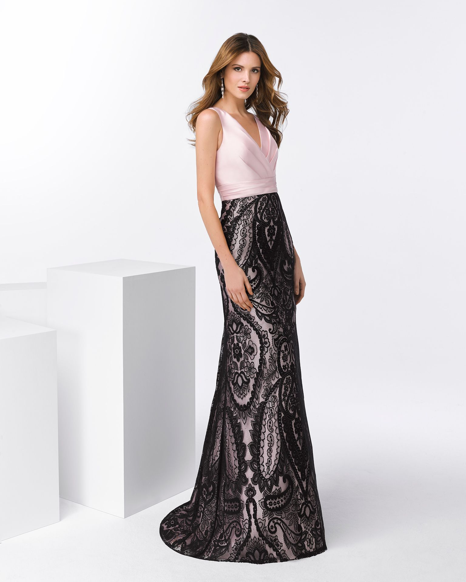 0fc0783a2 Long mikado cocktail dress with V-neckline, open back and skirt with lace  detailing. Available in black/pink, black/silver and black/coral.