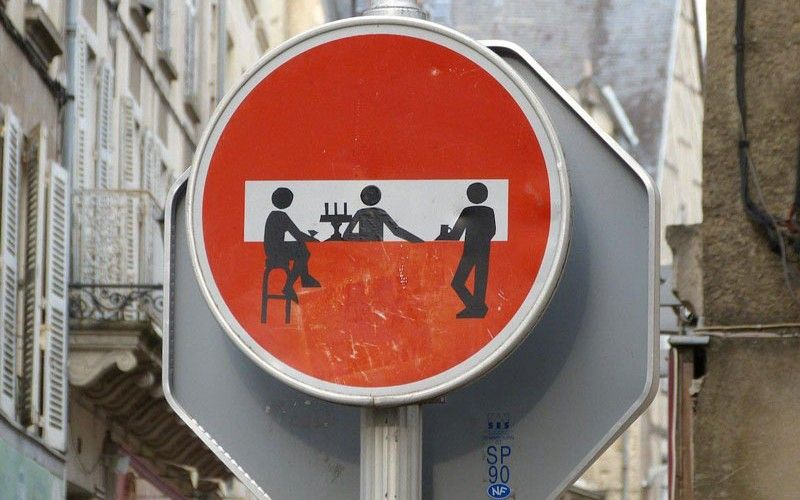 THE STREET BAR   Artwork by CLET     Spotted somewhere in France was this fun piece of street art by CLET. The manipulated 'Do Not Enter' sign depicts a bar setting with two patrons and a bartender. There's even a fancy candelabra in the scene!