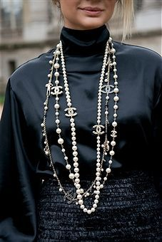 Street Style  Paris Fashion Week  Womenswear SpringSummer 2016  Day Eight  Fashion Blogger Thassia Naves wears a Chanel necklace skirt and shirt on day 8 during Paris Fas...