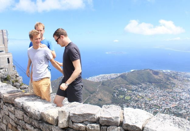 Got guts? These tourists decide to take posing for a photo a step further (literally) by standing behind the safety wall on Table Mountain