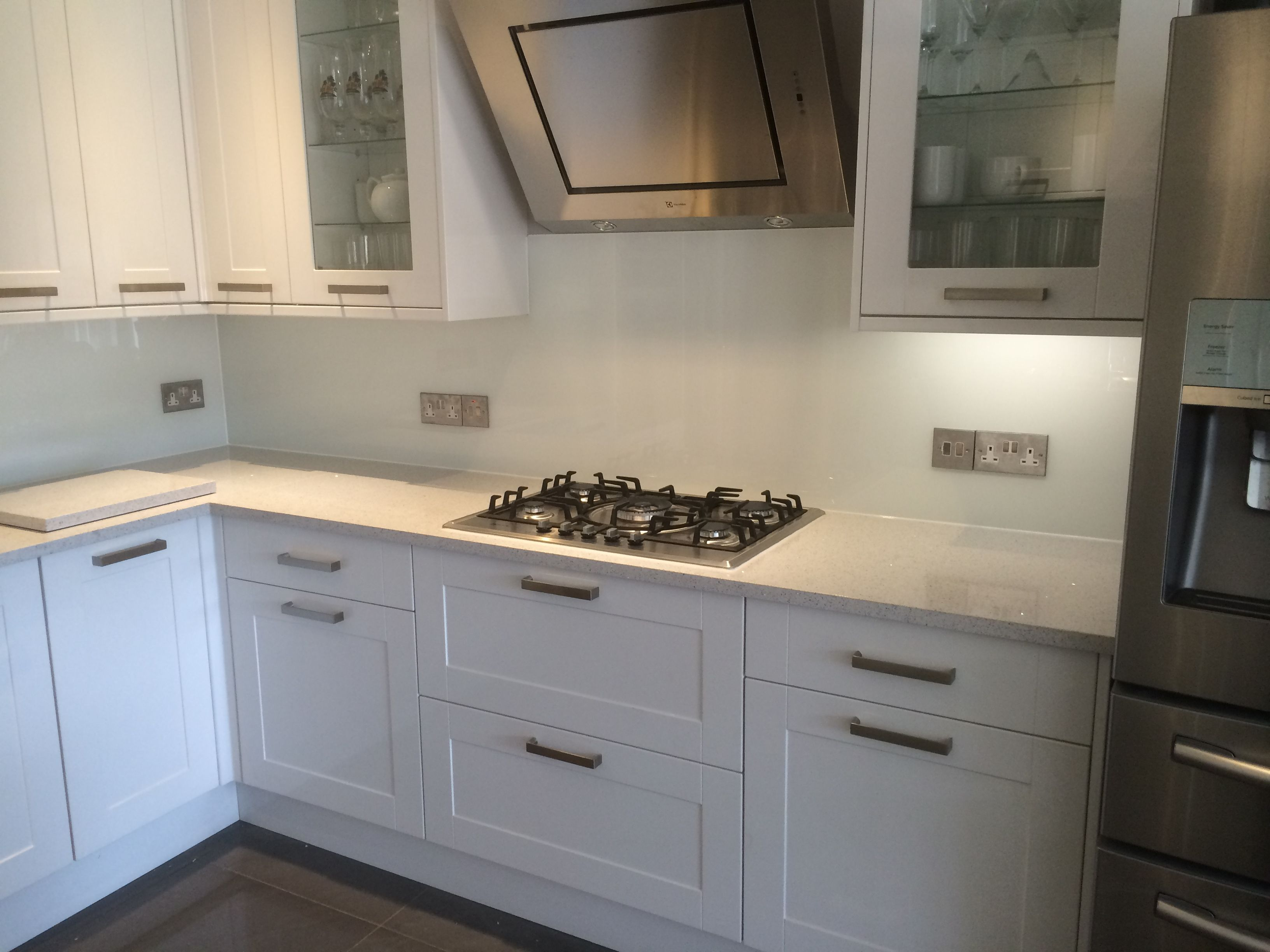 Contemporary White Glass Splashbacks Against Compac Lactea Quartz Worktops Kitchen Countertops