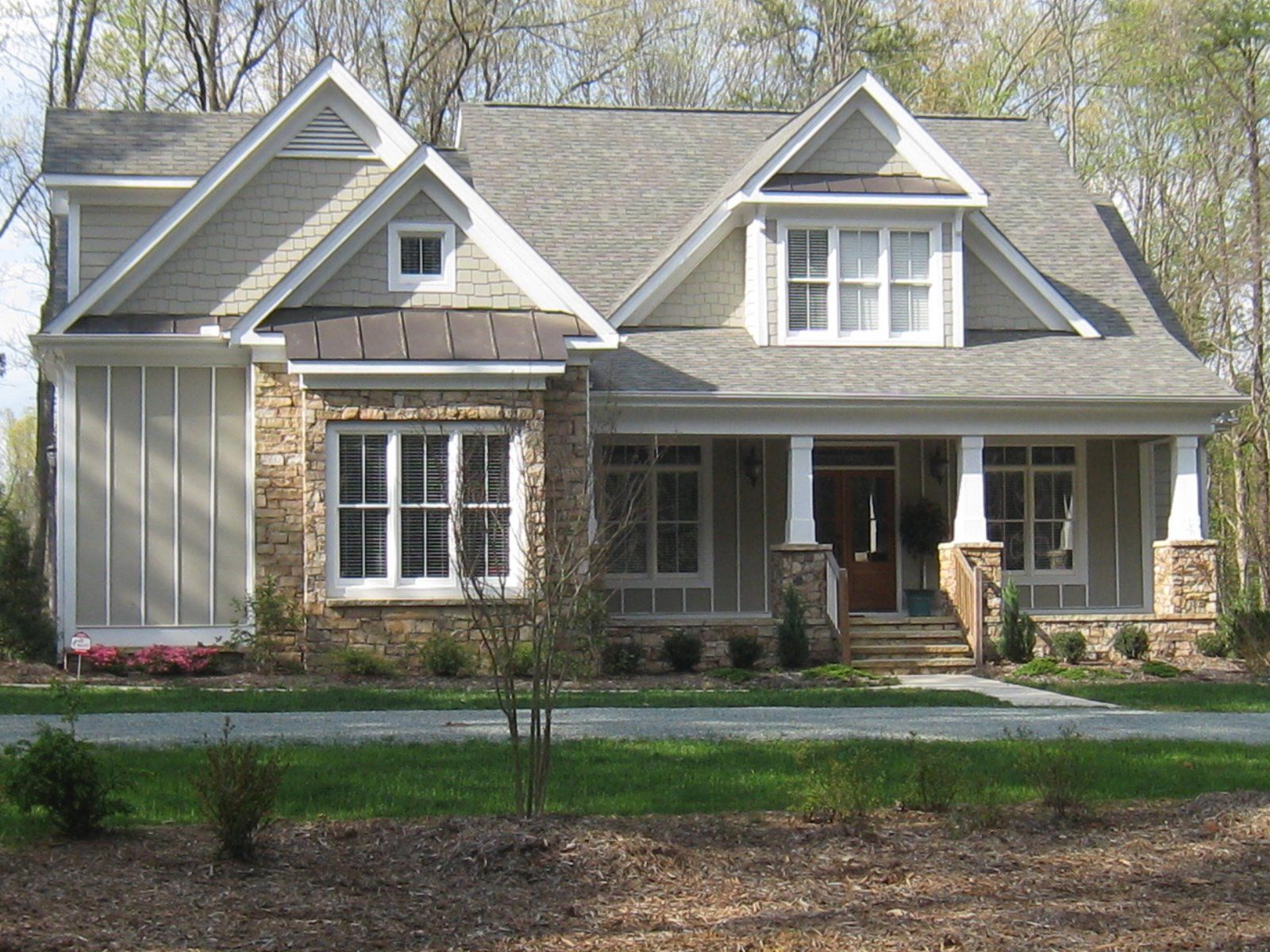 Attractive Rustic Roofing With Awesome Stones Wall Exposed Facade Craftsman Style Homes