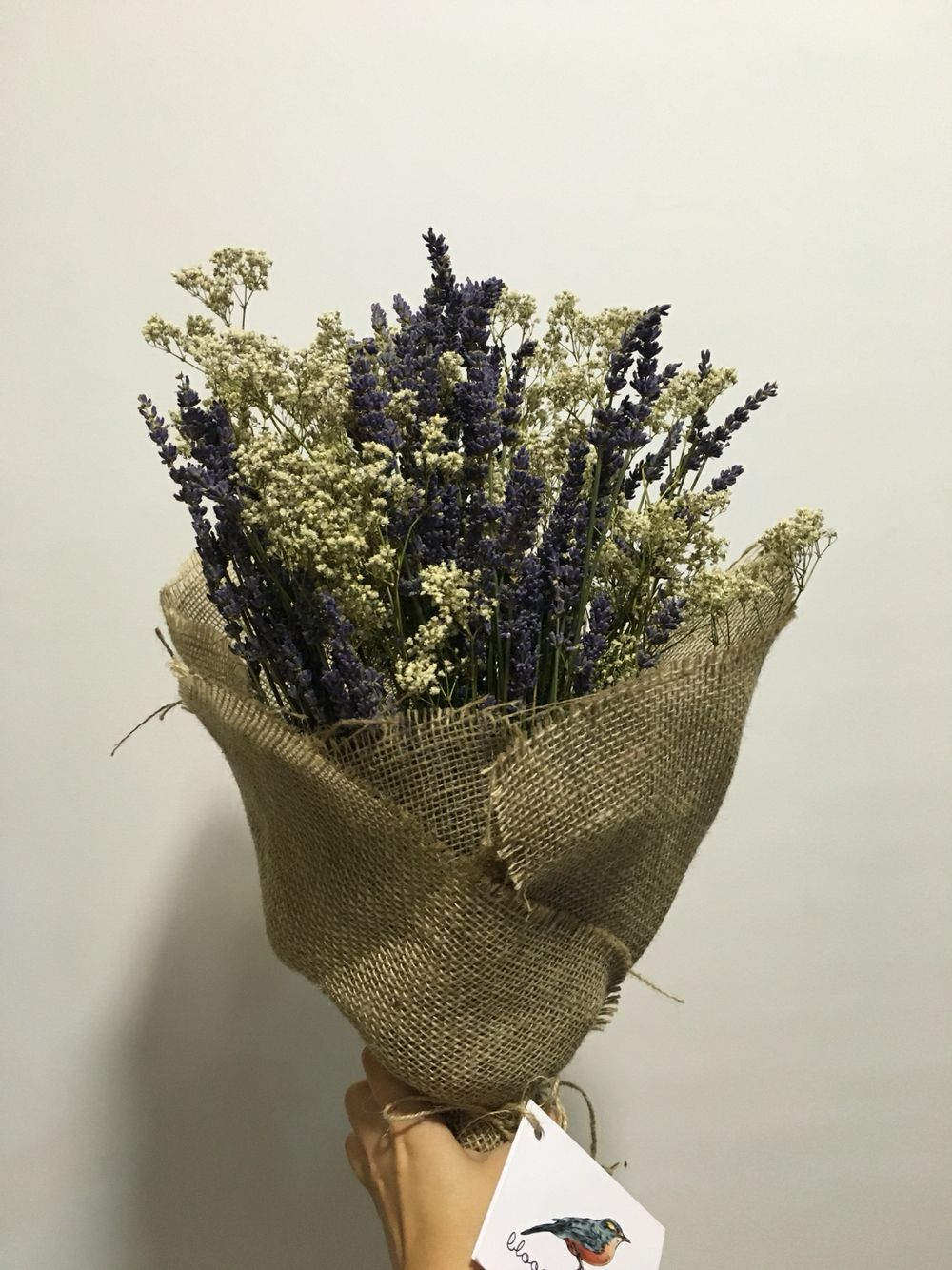 Dried lavender matched with baby breath bundled in brown