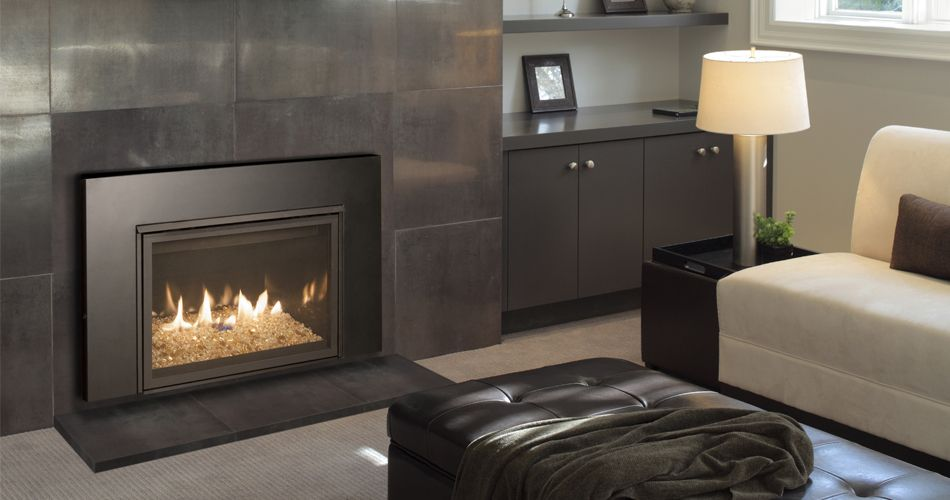 Gas insert - This Contemporary Gas Fireplace Features White Glass, Which Makes