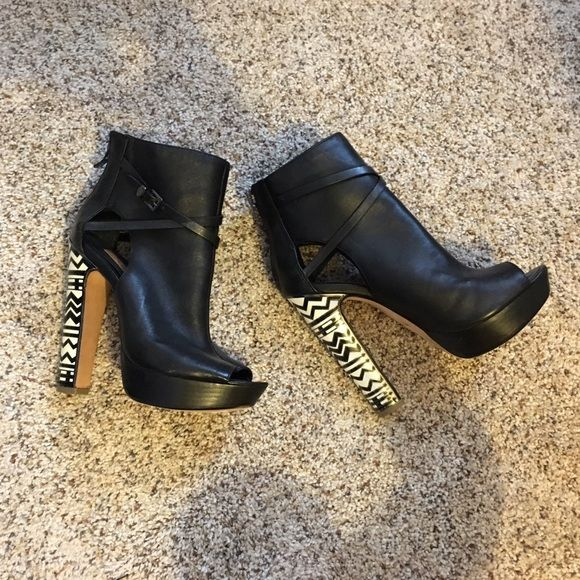 BCBGMaxAzria booties Never worn platform booties in black with a funky tribal print on the heel BCBGMaxAzria Shoes