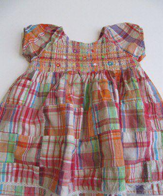 Cute madras plaid dress, smocked at top.