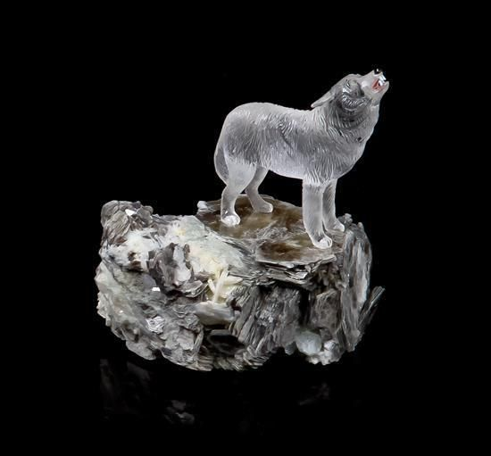 A rock crystal and multi stone quot arctic wolf carving th