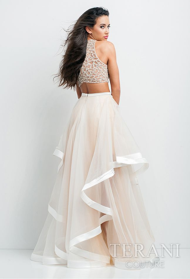 605dda98c0c5e Beautiful 2-piece ensemble featuring a nude, crystal embellished illusion  midriff top and sheer, gathered mesh skirt with ribbon accented high-low  hemline.