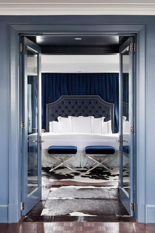 Blue Bedroom With Blue Velvet X Stools At Foot Of Bed Transitional Bedroom Blue Bedroom Decor Blue Master Bedroom Blue Bedroom