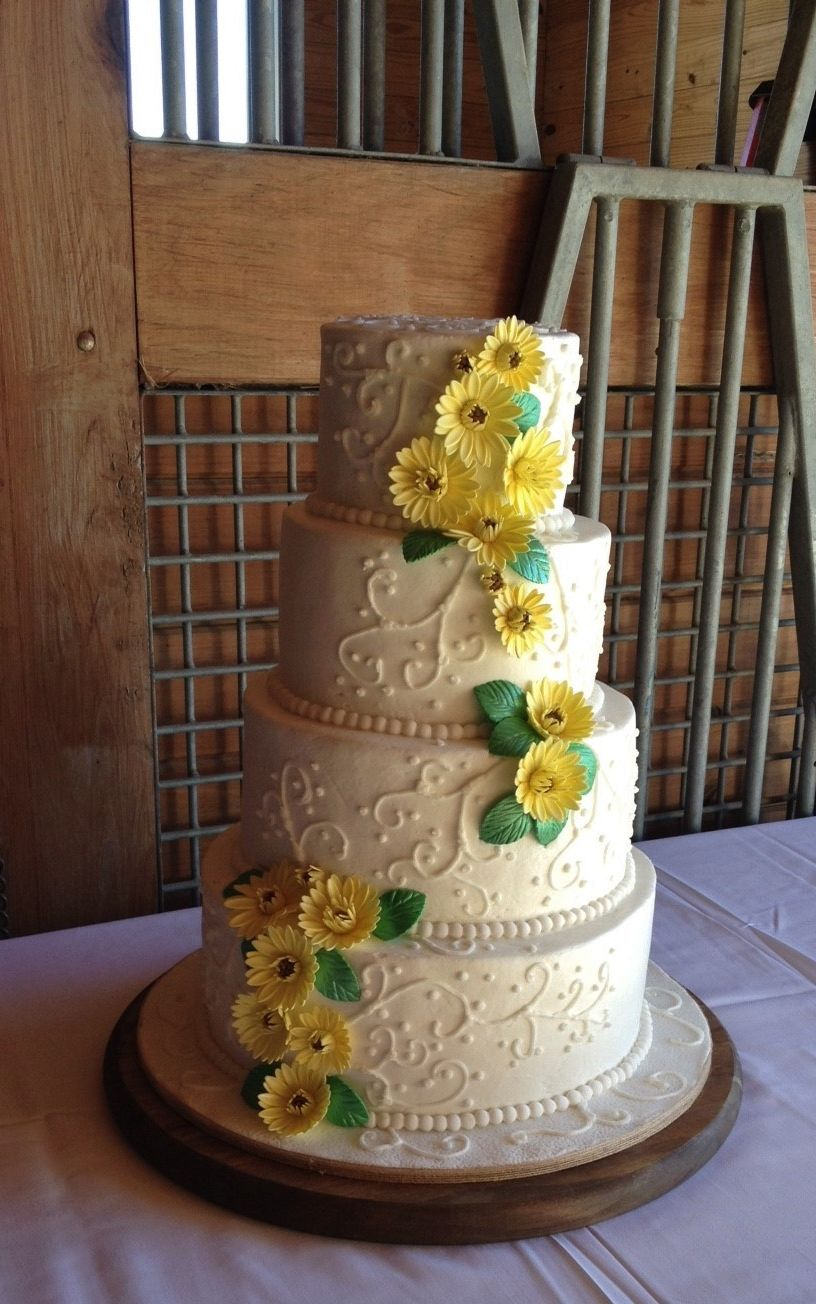 Country Theme Wedding cake with small sunflowers at a