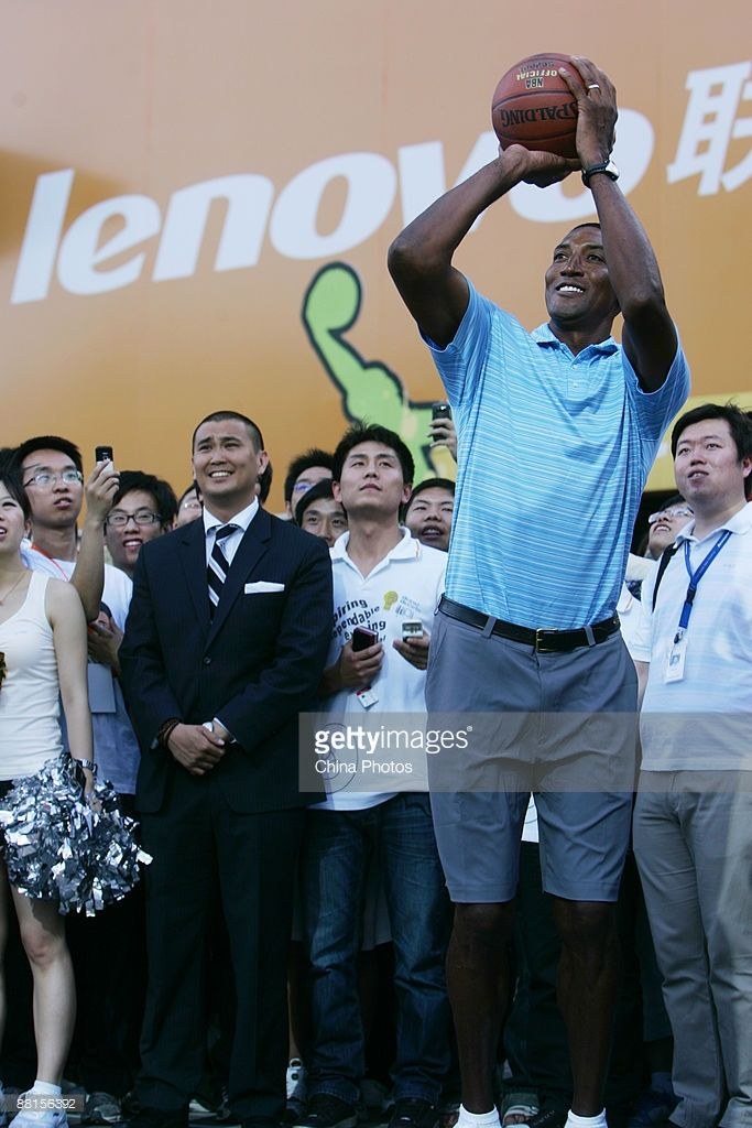 Former NBA player Scottie Pippen shoots during a launching ceremony of Lenovo's 'idea NBA' commemorative version laptop on June 2, 2009 in Beijing, China. Lenovo is China's largest PC maker.
