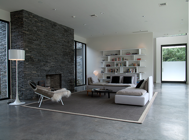 modern living room with concrete floor and minimal fireplace in a loft - Modern Living Room Flooring
