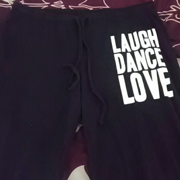 "Lounge pants Soft black lounge/yoga/PJ pants with words ""laugh dance love"" on upper left leg // gently loved // hey are comfortable, just too long for me Forever 21 Intimates & Sleepwear Pajamas"