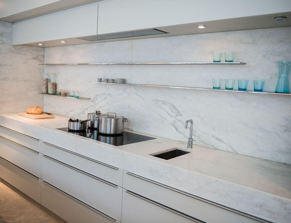A modern white kitchen that says luxury