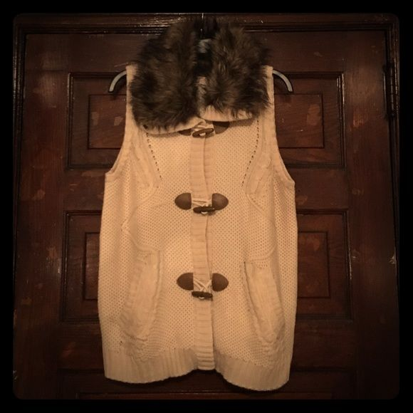 Sweater vest with fur collar Comfy, cozy, and adorable cream sweater vest. Brown faux fur collar. Fastens with buttons and faux leather and wood hooks. Has two big pockets in the front. Only worn once!!! Like new!!! Pink Republic Sweaters Cardigans