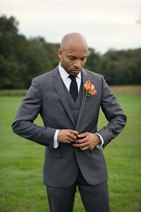 dark grey suit/vest with black tie flower in accent color