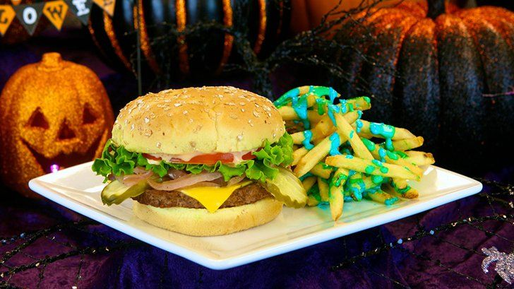 Pin for Later: 13 Taste-Bud-Shattering Foods That Prove 2015 Was the Best Year to Eat at Disneyland Cheeseburger and French Fries Covered in Ghostly Ooze OK, so maybe the ghostly ooze is really just parmesan-ranch sauce, but come on, it's blue!