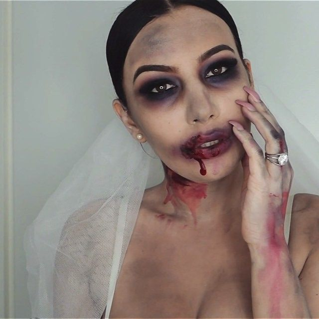 [Zombie bride-tutorial] This is a very messy look and also very simple to do. The key is to not be very precise, which is a plus. You only need a white body paint, black, red and purple eyeshadows, fake eyelashes, eye liner, mascara and fake blood!