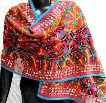 This stunning georgette dupatta/stole is embroidered with wool using traditional phulkari embroidery in a floral pattern, with little flat sequins stiched in at intervals. A great accessory for any look, any dress. - See more at: http://giftpiper.com/Stoles-Dupattas/Red-Georgette-Phulkari-Dupatta-Stole-id-210105.html#sthash.j7BdIgts.dpuf