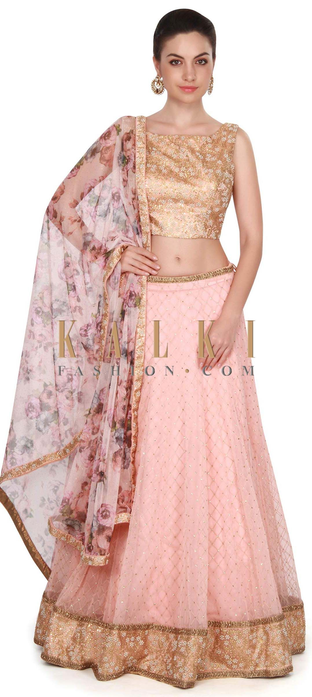 Pink lehenga in shimmer net with printed dupatta only on Kalki