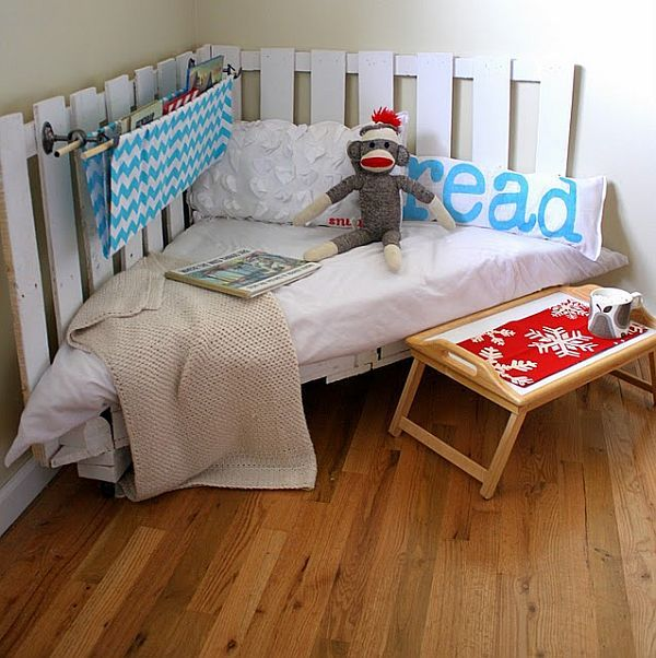 refurbished pallet kids' reading nook. This one is toooo adorable and looks so simple. What a GREAT way to get little ones into books