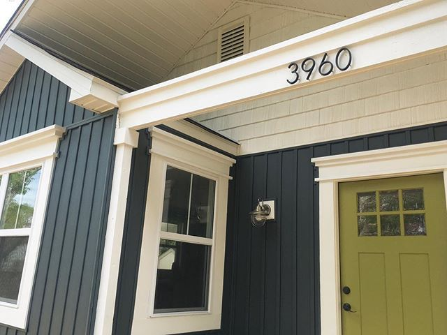 Dark blue home exterior with white trim.  Hale Navy. Board and batten siding.  Cedar shakes. Green front door curb appeal #boardandbattensiding