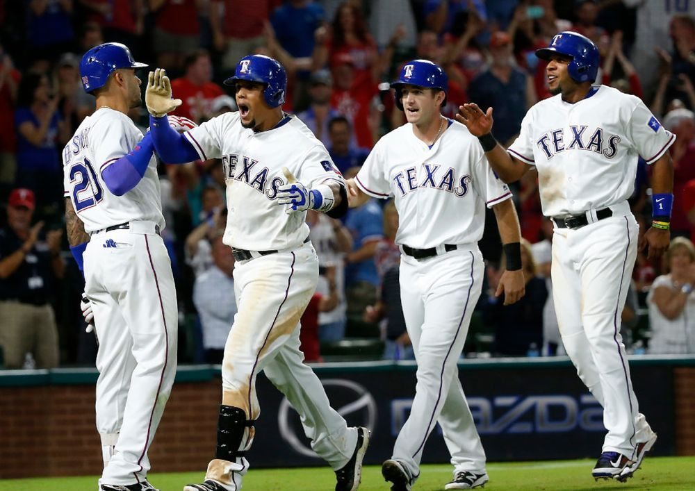 Carlos Gomez celebrates his 3run homer with Ian Desmond