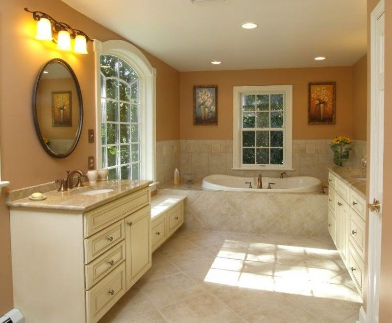 this beautiful master bath uses antique white finished cabinets to bring out the warmth of the - Antique White Bathroom Cabinets