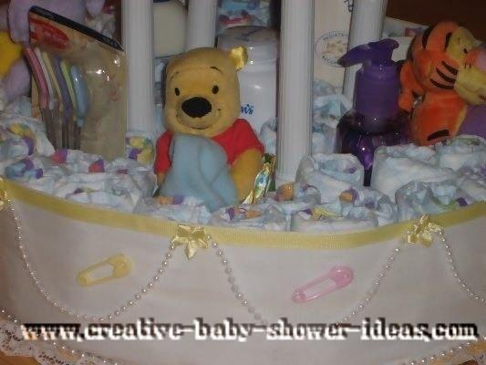 closeup of stuffed animals on winnie the pooh diaper cake