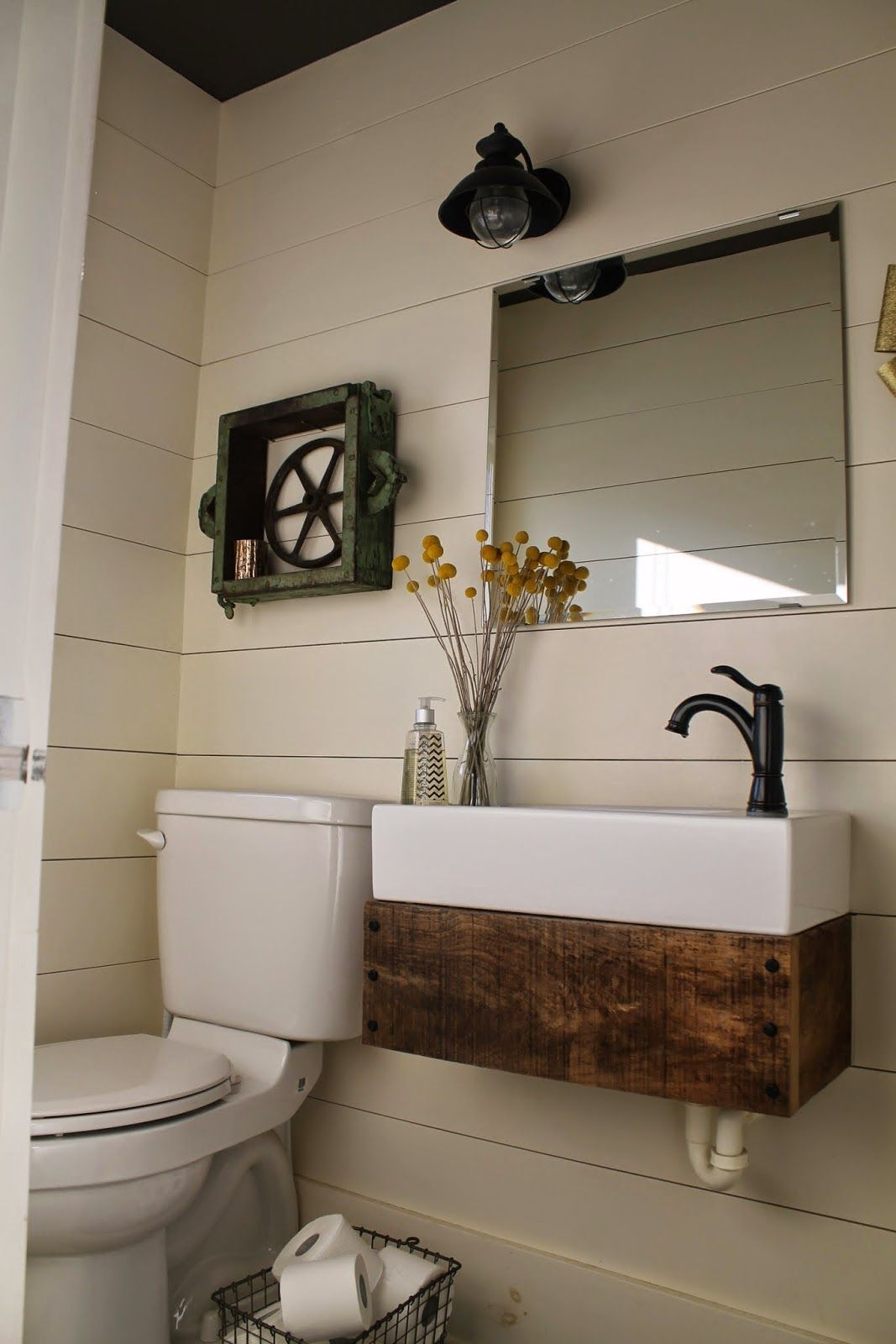 rustic reclaimed wood floating vanity in bathroom with planke ...