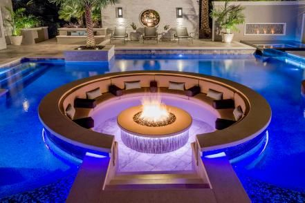 Tropical Pool With Sunken Fire Pit Seating Area