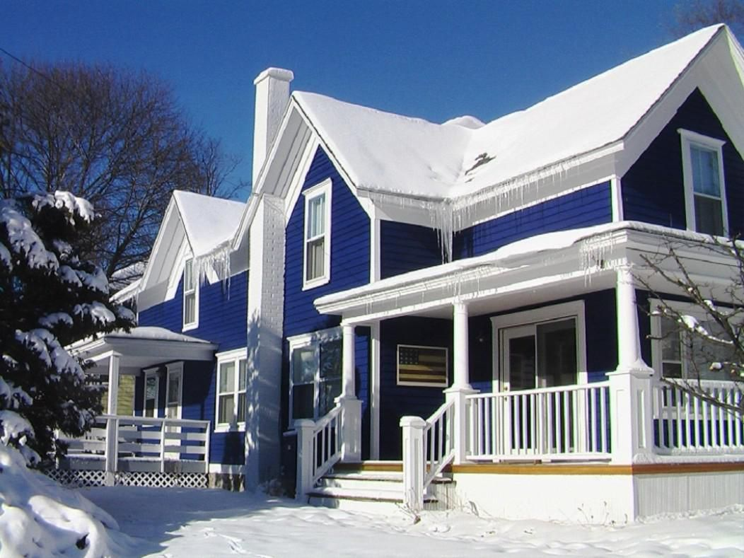 Magnificent duplex house with blue exterior paint idea for Building exterior colour