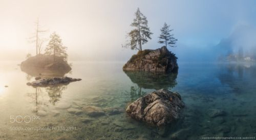 Germany. Ramsau. Lake Hintersee. Foggy morning by...  sky landscape lake forest water reflection nature travel island blue europe rock tourism tree summer