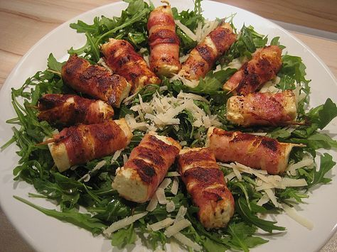 Photo of Fried bacon-wrapped sheep's cheese on rocket and parmesan salad