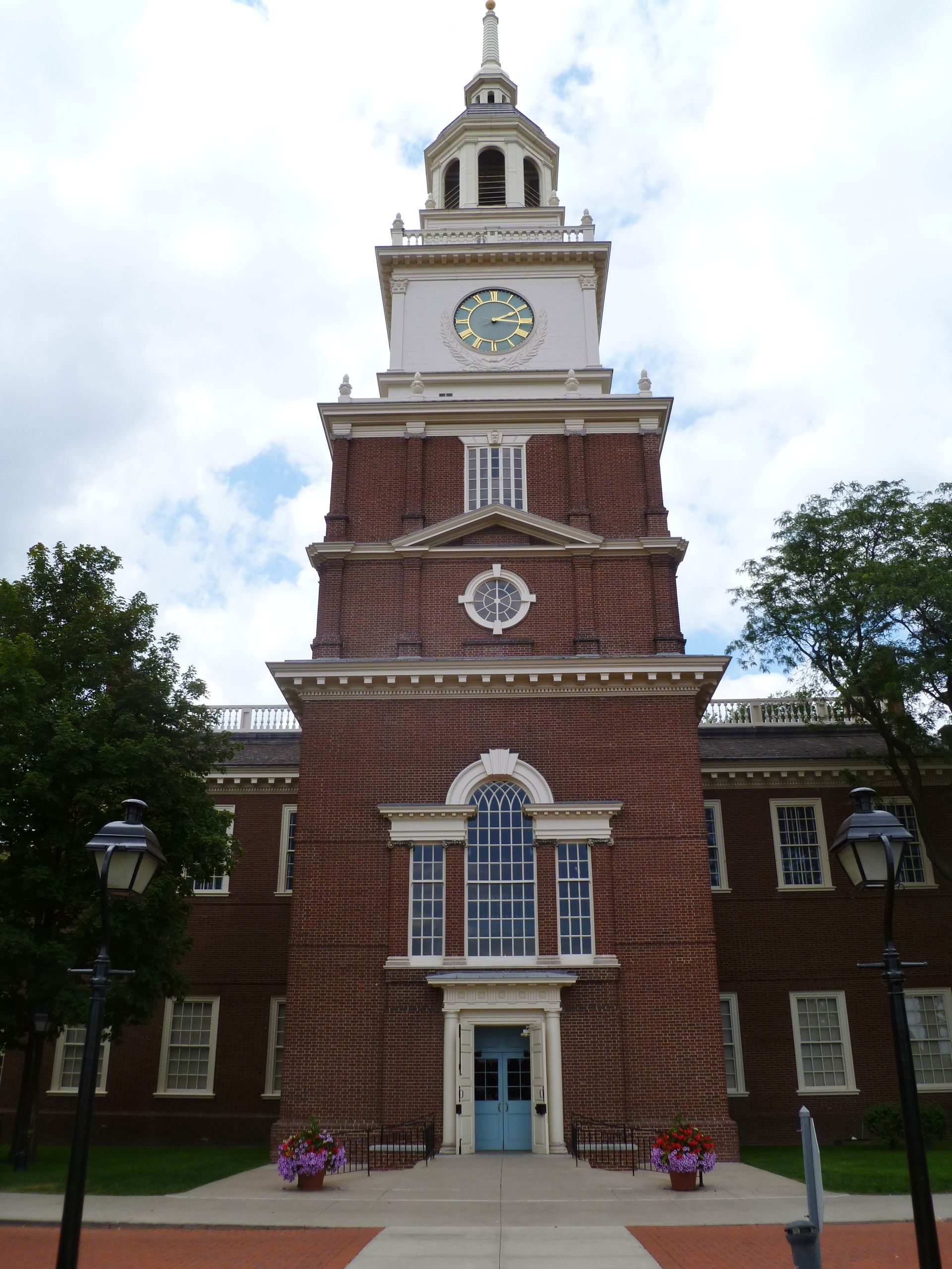 The clocktower facade of the henry ford museum in dearborn michigan is a replica of independence hall in philadelphia pennsylvania