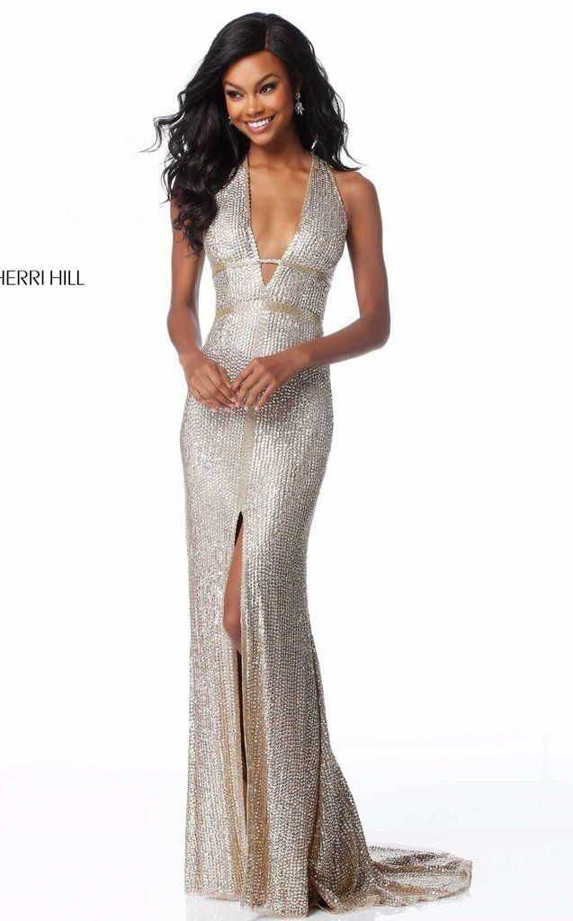4c96b627 Feel like you belong on a red carpet in this ultra glamorous Sherri Hill  fitted dress A sexy plunging neckline along the halter top bodice featur.