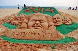Sand artist Sudarshan Pattnaik creates a sand sculpture to mark the beginning of year 2014..