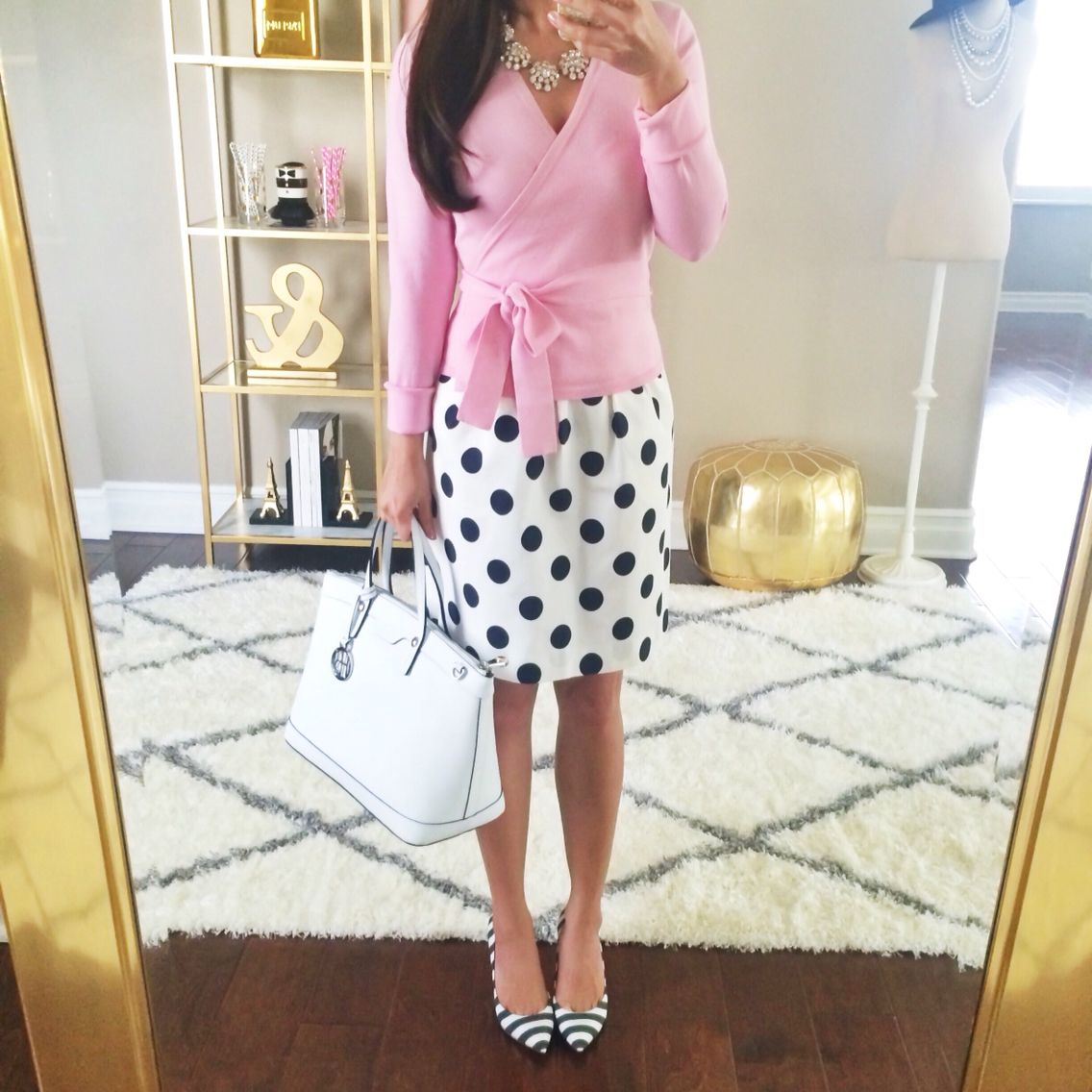 Ballerina pink wrap sweater, statement necklace, white and black polka dot skirt, striped pumps and white purse // Click the following link to see outfit details and photos:    http://www.stylishpetite.com/2015/03/dvf-spring-stripes-burberry-trench-coat.html