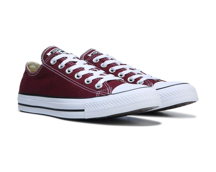 2df1bd0aa8e0 Go with a classic in the iconic Converse Chuck Taylor All Star Low Top  Sneaker.Canvas upper Lace-up front Contrast accentsVulcanized striped  rubber midsole