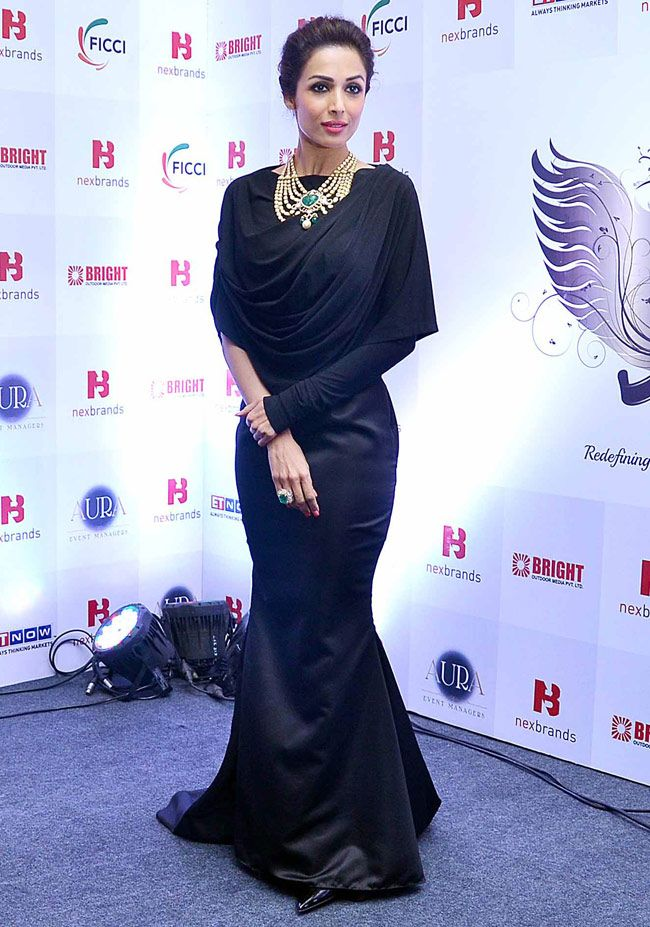 048607f1a13 Malaika Arora Khan looks beautiful in a black gown at a Jewellery event in  Mumbai.  Bollywood  Fashion  Style  Beauty