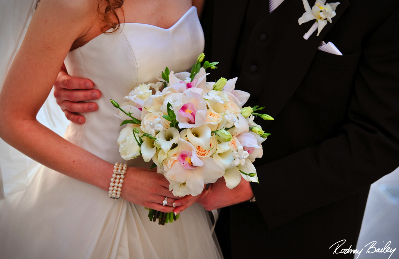 Calla lily bridal bouquet bridal bouquet tea rose violet classic wedding with a classic bridal bouquet comprised of white cymbidium orchids white lisianthus white roses stephanotis and white mini calla lilies izmirmasajfo Choice Image