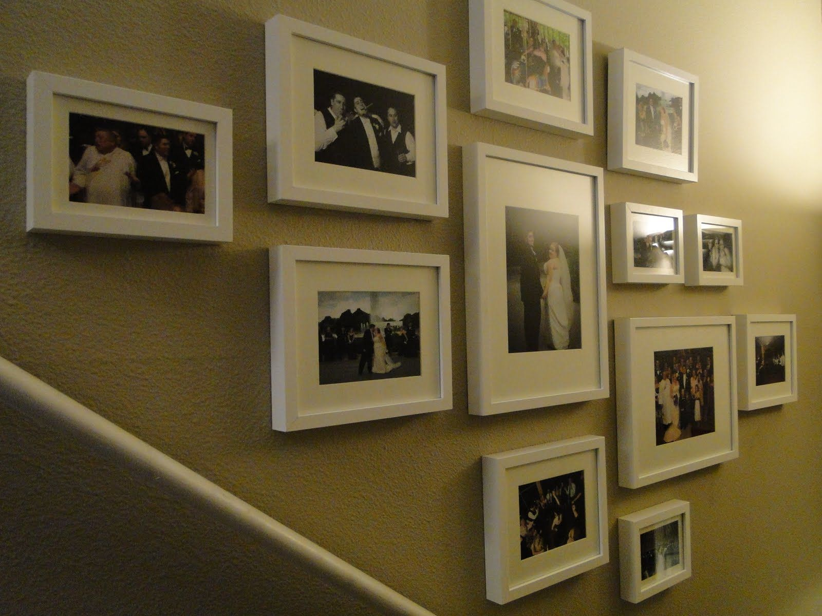 Wedding frame collage along the stairs using IKEA picture frames. (Source  with wall papering