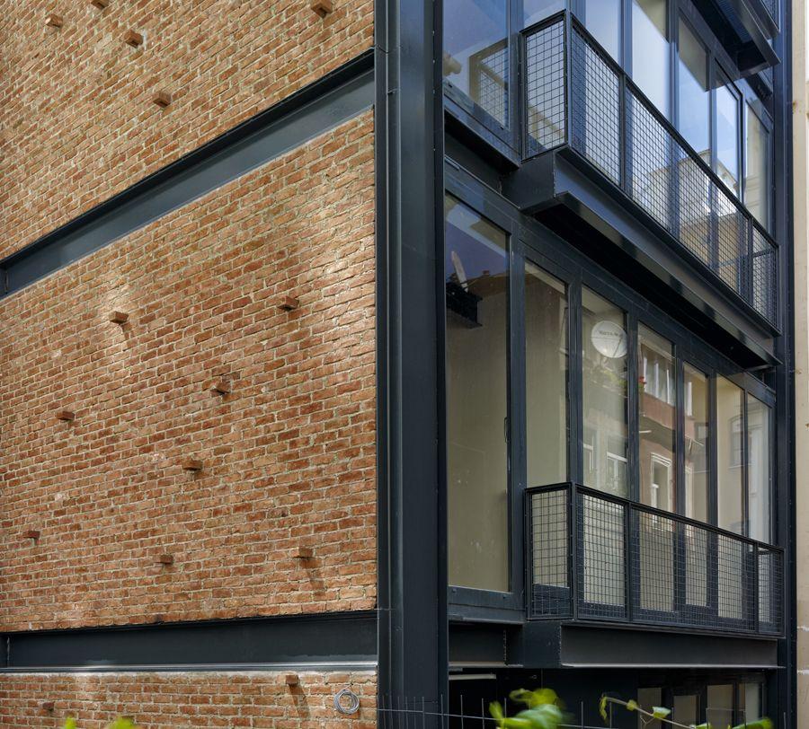 Bricks steel glass facade noxx apartman outdoors for Brick house construction