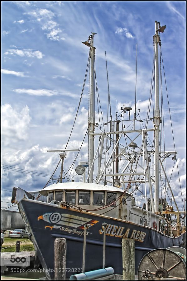 """The """"SHEILA RENE"""" at Wanchese Harbor - Pinned by Mak Khalaf A shrimper at the docks with a cloud filled sky. Fine Art North Carolinacloudsharborshrimperskysummer by TomShacochis"""