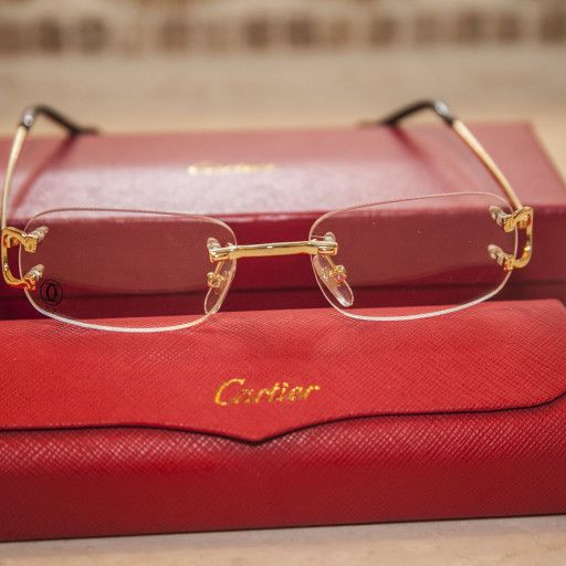 """35d56a48d6 This simple and elegant design is marked with a Cartier """"C"""" décor. Rimless"""