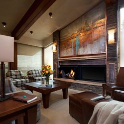 Fireplace next to tv with hearth